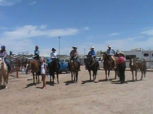 A group of horses and riders lined up and ready for a class during a St. Vrain Roundup Club show at the Boulder County Fairgrounds