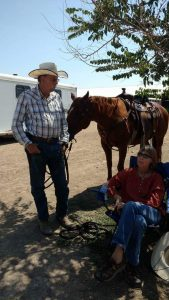A couple and their horse take a break in the shade between classes at a St. Vrain Roundup Club show