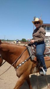 A female rider takes a quick break between classes at a St. Vrain Roundup Club show.