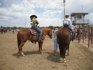 Club members help each other out with last minute adjustments and advice before starting a class at a St. Vrain Roundup Club show.