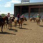 Horses and riders waiting to enter the arena for a western class at a St. Vrain Roundup Club show